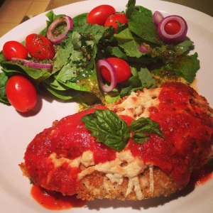Quinoa Crusted Chicken Parmesan with salad with homemade Italian dressing